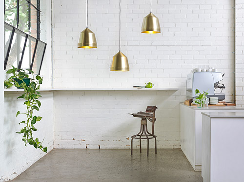 Kate's 'Mr Cooper' brass pendant lights. Image via Temple & Webster